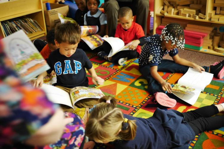 Children Reading Books in Classroom Setting